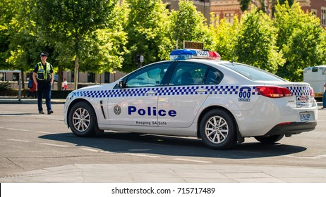 Adelaide, Australia - November 14, 2015: South Australian police car closed the street in  Adelaide's CBD on a day with the policeman patrolling on the background