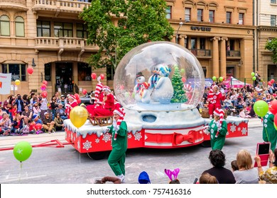 Adelaide, Australia - November 18, 2017: Parade participants walk along crowd of people during Adelaide's 85th Credit Union Christmas Pageant parade