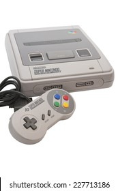 ADELAIDE, AUSTRALIA - October 27 2014:A studio shot of a Super nintendo video game device. A popular  16-bit entertainment system sold worldwide during the 1990's.