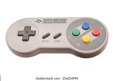 ADELAIDE, AUSTRALIA - October 27 2014:A studio shot of a Super nintendo video game controller. A popular 16-bit entertainment system sold worldwide during the 1990's.