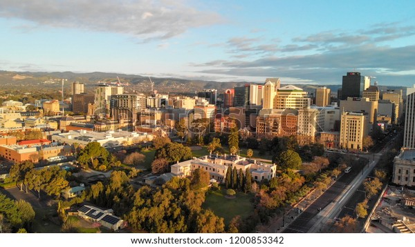 ADELAIDE, AUSTRALIA - SEPTEMBER 16, 2018: Aerial view of city skyline at sunset. Adelaide is the main city of South Australia State.