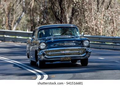 Adelaide, Australia - September 25, 2016: Vintage 1957 Chevrolet Bel Air coupe driving on country roads near the town of Birdwood, South Australia.