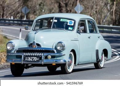 Adelaide, Australia - September 25, 2016: Vintage 1954 Holden FJ sedan driving on country roads near the town of Birdwood, South Australia.