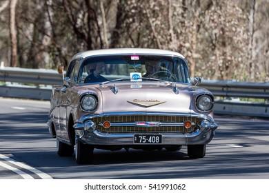Adelaide, Australia - September 25, 2016: Vintage 1957 Chevrolet Belair Sports Sedan driving on country roads near the town of Birdwood, South Australia.