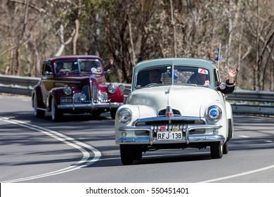 Adelaide, Australia - September 25, 2016: Vintage 1955 Holden FJ Sedan driving on country roads near the town of Birdwood, South Australia.