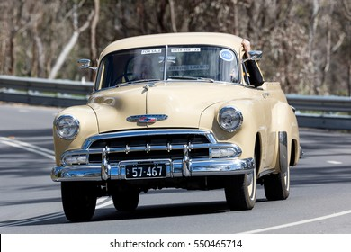 Adelaide, Australia - September 25, 2016: Vintage 1957 Chevrolet Utility driving on country roads near the town of Birdwood, South Australia.