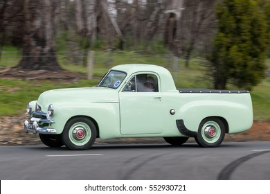 Adelaide, Australia - September 25, 2016: Vintage 1956 Holden FJ Utility driving on country roads near the town of Birdwood, South Australia.