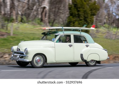 Adelaide, Australia - September 25, 2016: Vintage 1955 Holden FJ Sedan driving on country roads near the town of Birdwood, South Australia.