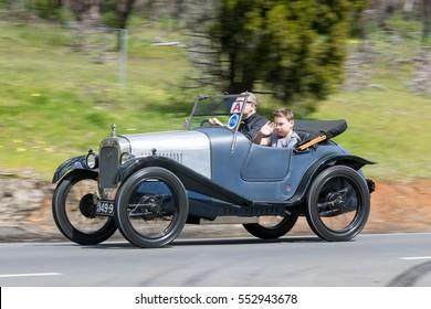 Adelaide, Australia - September 25, 2016: Vintage 1946 Austin 16 Sedan driving on country roads near the town of Birdwood, South Australia.