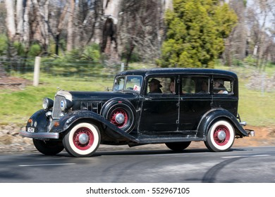 Adelaide, Australia - September 25, 2016: Vintage 1933 Chrysler CT Sedan driving on country roads near the town of Birdwood, South Australia.