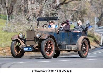 Adelaide, Australia - September 25, 2016: Vintage 1924 Oldsmobile 30 Tourer driving on country roads near the town of Birdwood, South Australia.