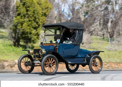 Adelaide, Australia - September 25, 2016: Vintage 1913 Ford T Turtle deck driving on country roads near the town of Birdwood, South Australia.