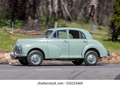 Adelaide, Australia - September 25, 2016: Vintage 1950 Morris Oxford Sedan driving on country roads near the town of Birdwood, South Australia.