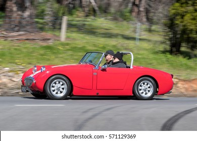 Adelaide, Australia - September 25, 2016: Vintage 1959 Austin Healey Sprite bugeye Tourer driving on country roads near the town of Birdwood, South Australia.