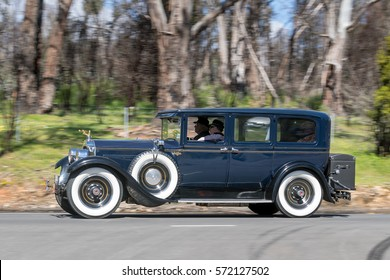 Adelaide, Australia - September 25, 2016: Vintage 1927 Packard Sedan driving on country roads near the town of Birdwood, South Australia.