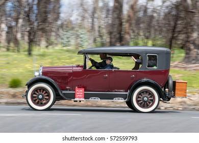 Adelaide, Australia - September 25, 2016: Vintage 1925 Studebaker Standard Six Sedan driving on country roads near the town of Birdwood, South Australia.