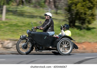 Adelaide, Australia - September 25, 2016: Vintage Motorcycle with sidecar on country roads near the town of Birdwood, South Australia