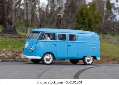 Adelaide, Australia - September 25, 2016: Vintage 1959 Volkswagen Kombi Van driving on country roads near the town of Birdwood, South Australia.