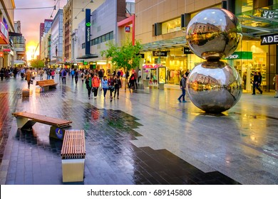 Adelaide, Australia - September 30, 2016: People walking along the Rundle Mall in Adelaide CBD at sunset, viewing towards West. Rundle Mall is the premier shopping area of South Australia