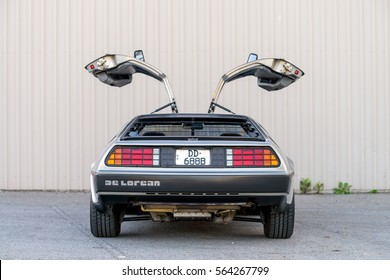Adelaide, Australia - September 7, 2013: DeLorean DMC-12 car with opened doors parked on street near shed