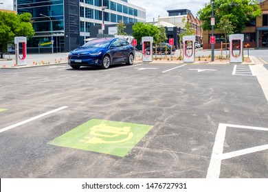 Adelaide CBD, Australia - November 18, 2017: Electric cars charging station with Tesla Model X car charging on a day in city centre on Franklin Street