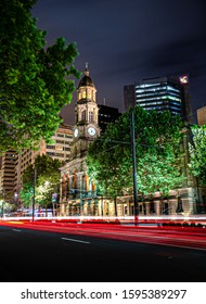 Adelaide City at night, photo with long exposure, colors, reflection and light trail. city and trees, old and new buillding.