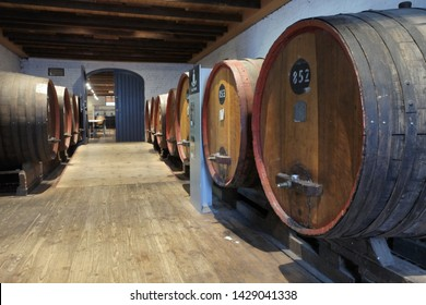 ADELAIDE - MAY 14 2019:Large Oak wine barrels in vineyard wine cellar in Barossa Valley in South Australia. Barossa Valley is a renowned wine-producing region northeast of Adelaide in South Australia