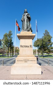 Adelaide, South Australia / Australia - August 23 2019: Queen Victoria statue viewed from the north, Victoria Square, Adelaide, South Australia. Bronze monument in the city centre.