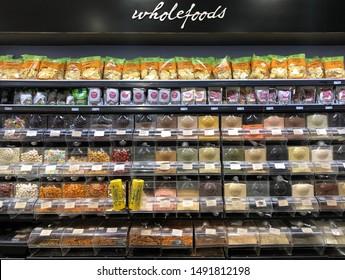 Adelaide, South Australia - August 30th 2019 - Display of wholefoods in bulk buy bins in supermarket.