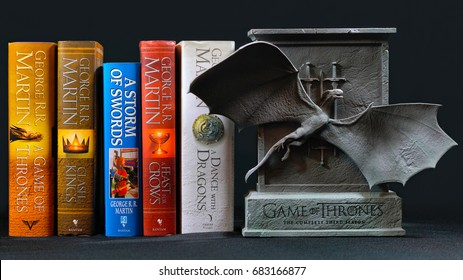 ADELAIDE, SOUTH AUSTRALIA - JULY 12, 2017: Popular fantasy hardcover books, A Song of Ice and Fire, by George R R Martin, with Game of Thrones dragon cover DVD collection