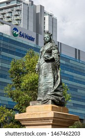 Adelaide, South Australia / Australia - July 27 2019: Queen Victoria statue, Victoria Square, Adelaide, South Australia. Bronze monument in the city centre.