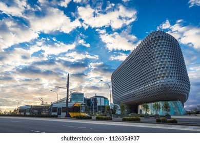 Adelaide, South Australia / Australia - June 24 2018: North Terrace in the city of Adelaide a tram passing the RAH and SAHMRI Building