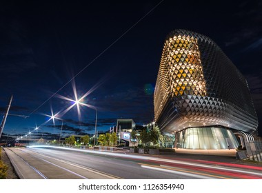 Adelaide, South Australia / Australia - June 24 2018: SAHMRI Building on North Terrace at Blue Hour with tram tracks in foreground