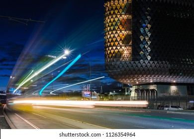 Adelaide, South Australia / Australia - June 24 2018: SAHMRI Building on North Terrace with long exposure of tram travelling into the city centre