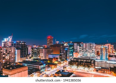 Adelaide, South Australia - June 5, 2020: Adelaide CBD skyline illuminated at night viewed towards hills