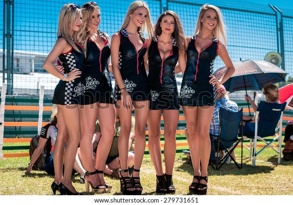 Adelaide, South Australia - March 01, 2014: Grid girls are interacting with visitors at Clipsal 500 V8 Supercars