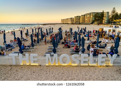 Adelaide, South Australia - March 11, 2018: People at The Moseley Beach Club cafe enjoying their time and sunset view on a summer evening