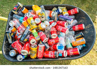 Adelaide, South Australia - May 6, 2018: Pile of soft drink cans and plastic bottles collected after public event and ready for recycling