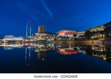 Adelaide, South Australia - October 31, 2018: Oz Asia Festival on the banks of the torrens river in Adelaide city after sunset at blue hour.