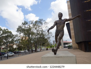 ADELAIDE, SOUTH AUSTRALIA. - On November 07, 2018. – A statue commemorates AFL footballer Malcolm Blight.  The statue shows Blight launching a long kick at in front of Adelaide Oval.