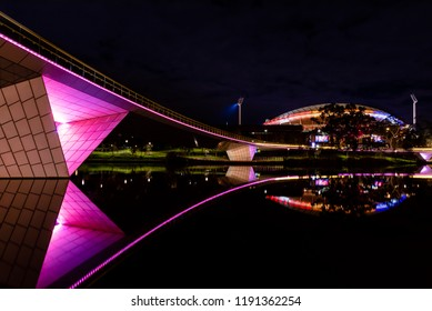 Adelaide, South Australia - September 2018: Adelaide Oval and bridge over the River Torrens lit up at night time.