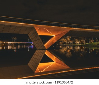 Adelaide, South Australia - September 2018: Bridge over the River Torrens lit up at night time.