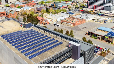 Adelaide, South Australia - September 30, 2017: Top view of solar panel farm set up on building roof in Adelaide CBD on a day