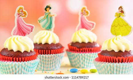 Adelaide, South Adelaide - June 15, 2018: Children's birthday party princess themed cupcakes, close up against a colorful pastel background.