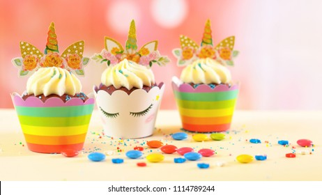 Adelaide, South Adelaide - June 15, 2018: Children's birthday party unicorn and rainbow themed cupcakes, close up against a colorful pastel background, with copy space.