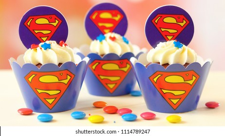 Adelaide, South Adelaide - June 15, 2018: Children's birthday party superman themed cupcakes, close up against a colorful pastel background.