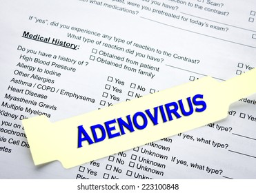 A adenovirus patient bracelet on top of a hospital questionnaire paperwork