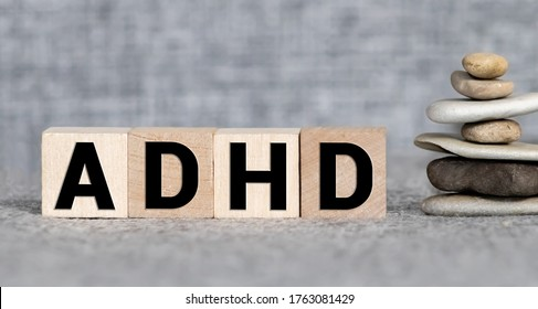 ADHD abbreviation on wooden blocks. ADHD is Attention deficit hyperactivity disorder. Close up. Vignette.