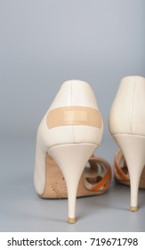 Adhesive bandage attached to summer high heels. Closeup