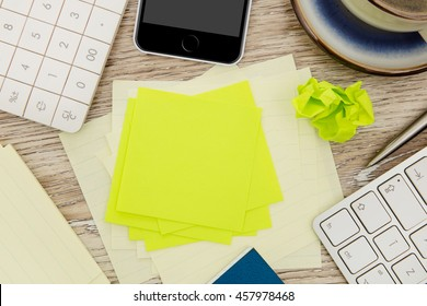 Adhesive note on messy desk
